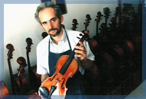 Rolland Holding a Violin